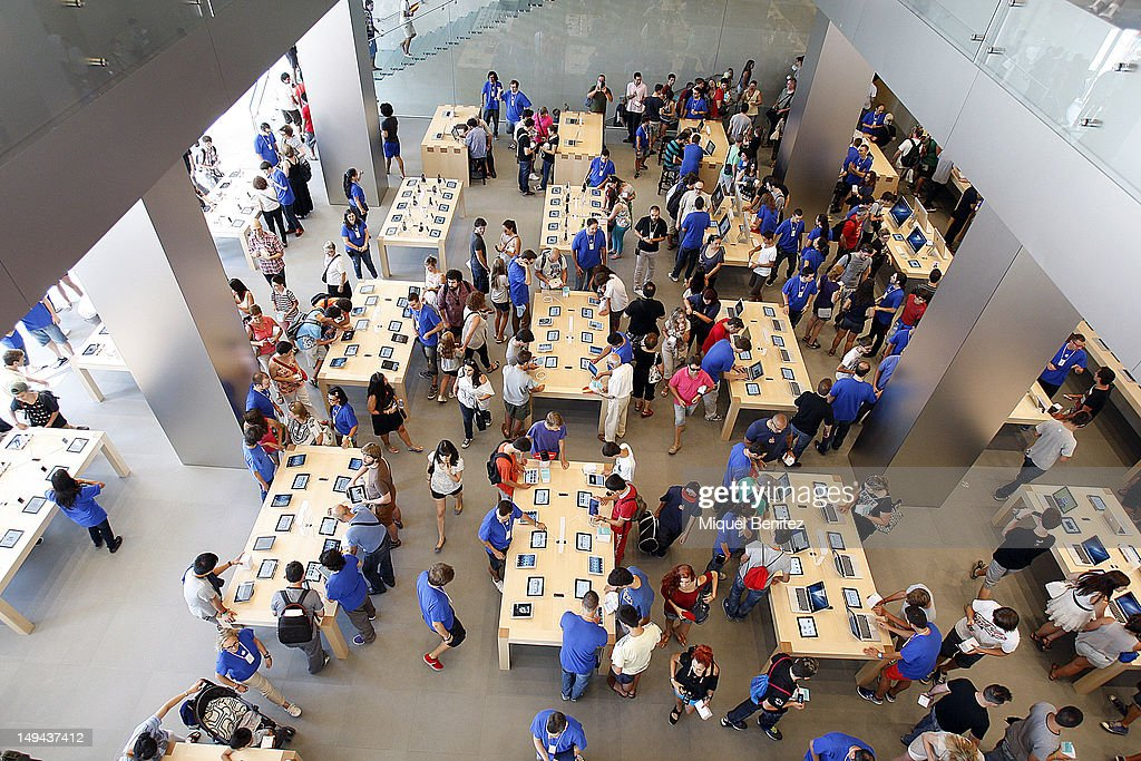 People attend the opening of Apple's new Barcelona store in Passeig de Gracia on July 28, 2012 in Barcelona, Spain.