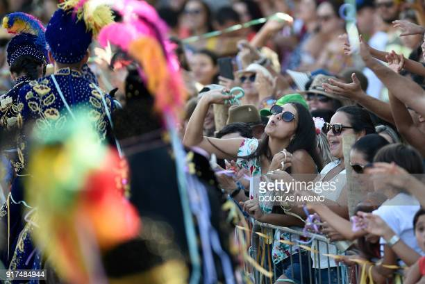People attend the parade of the traditional carnival on horseback in Bonfim Minas Gerais state southeastern Brazil on February 12 2018 Dressed in...