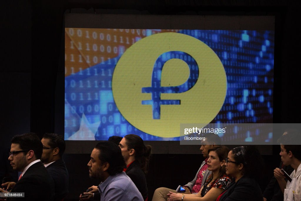 People attend the Petro cryptocurrency launch event in Caracas, Venezuela, on Tuesday, Feb. 20, 2018. Maduro launched Petro to use as a new alternative payment system amid hyperinflation and the eroding bolivar. Photographer: Wil Riera/Bloomberg via Getty Images