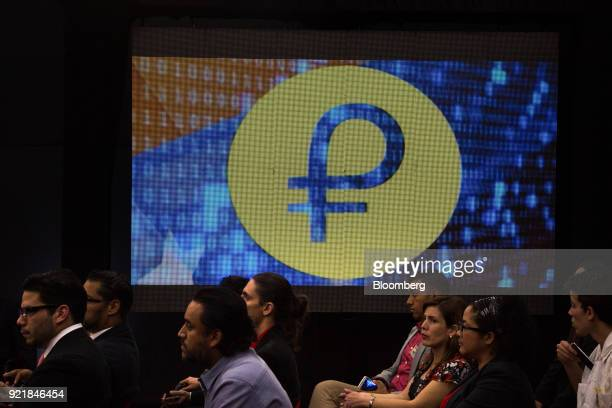 People attend the Petro cryptocurrency launch event in Caracas Venezuela on Tuesday Feb 20 2018 Maduro launched Petro to use as a new alternative...