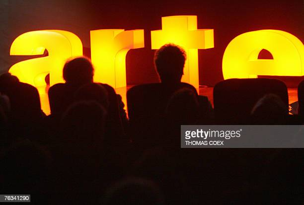 People attend the presentation of Franco-German TV channel Arte's upcoming season programs, during a press conference, 27 August 2007 in Paris. AFP...