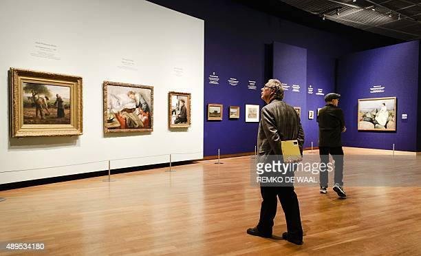 People attend the press preview of the exhibition 'Munch Van Gogh' on the works of Dutch artist Vincent Van Gogh and Norwegian artist Edvard Munch at...
