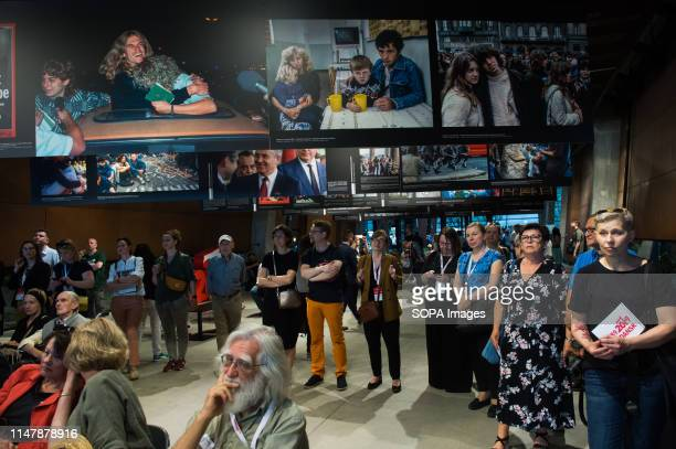 People attend the private view of the British-Polish photographer Chris Niedenthal's exhibition during the 30th Anniversary of free elections in...