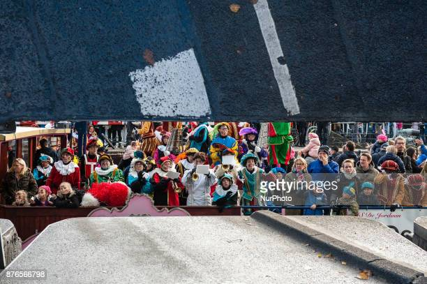 People attend the Saint Nicholas parade in Amsterdam Netherlands on November 19 2017 With more than a kilometre of floats and boats Amsterdam hosts...