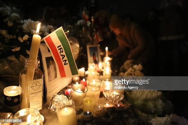 People attend the Seventh Day Vigil for Iran plane crash victims at Civic Plaza in front of North Vancouver City Hall BC Canada on January 14 2020 A...