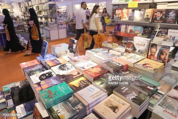 People attend the Sharjah International Book Fair in Sharjah northeast of Dubai on October 31 2018 The fair will be held between October 31 and...