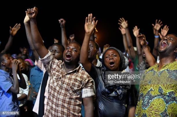People attend the speech of German pentecostal evangelist Reinhard Bonnke during his farewell gospel crusade on November 9 2017 in Lagos / AFP PHOTO...