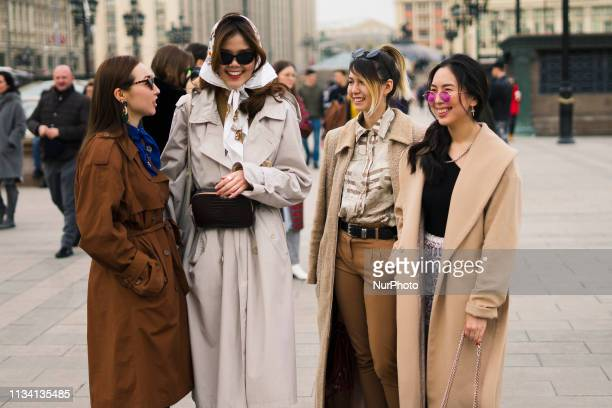 People attend the Street Style Mercedes Benz Fashion Week Russia Fall/Winter 2019/2020 Day Two in Moscow Russia on March 31 2019