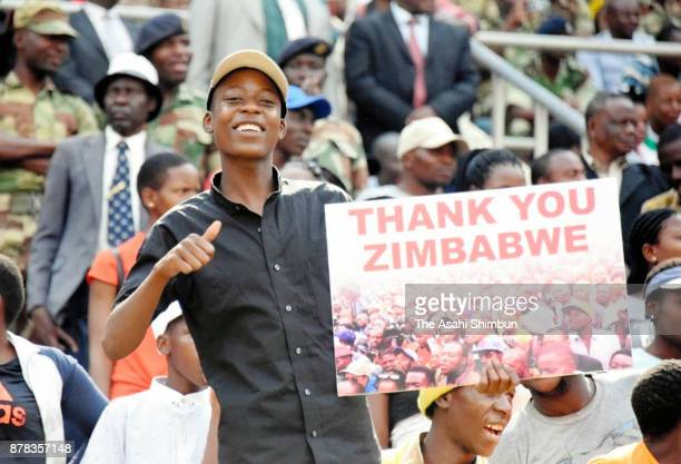 People attend the swornin ceremony of new Zimbabwe President Emmerson Mnangagwa on November 24 2017 in Harare Zimbabwe