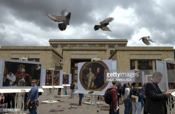 People attend the The Prado Museum in Bogota exhibition which displays reproductions of the most iconic works of Madrid's Prado Museum and an...