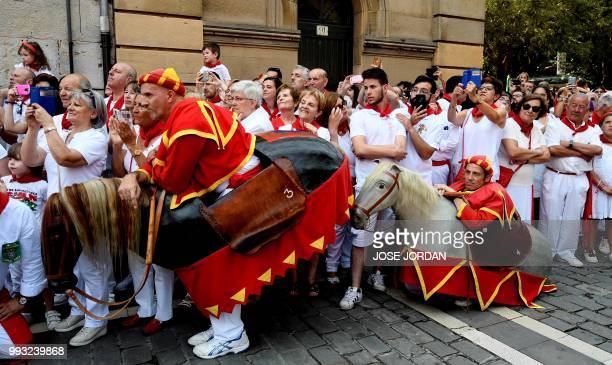 People attend the the procession of Pamplona´s patron Saint Fermin on the first day of the San Fermin bull run festival in Pamplona northern Spain on...