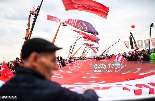 People attend the Turkey's Nationalist Movement Party's meeting on April 9 2017 during a campaign rally for the 'yes' vote in a constitutional...
