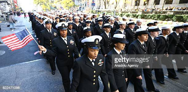 People attend the Veterans Day Parade in New York City on November 11 2016 in New York City Known as 'America's Parade' it features over 20000...
