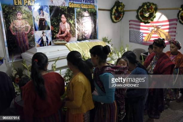 People attend the wake of Claudia Gomez a 19yearold Guatemalan woman who was allegedly shot and killed by a US border patrol agent in the village of...