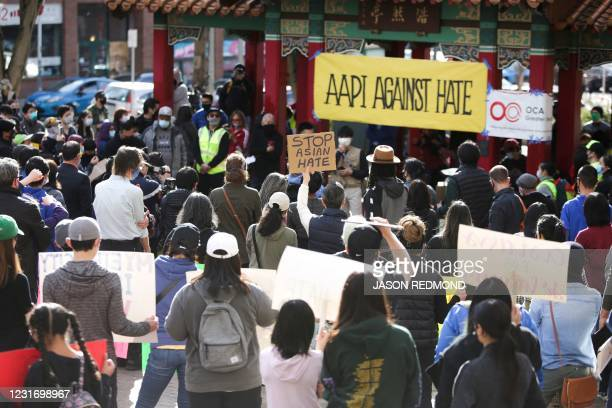 "People attend the ""We Are Not Silent"" rally against anti-Asian hate in response to recent anti-Asian crime in the Chinatown-International District of..."