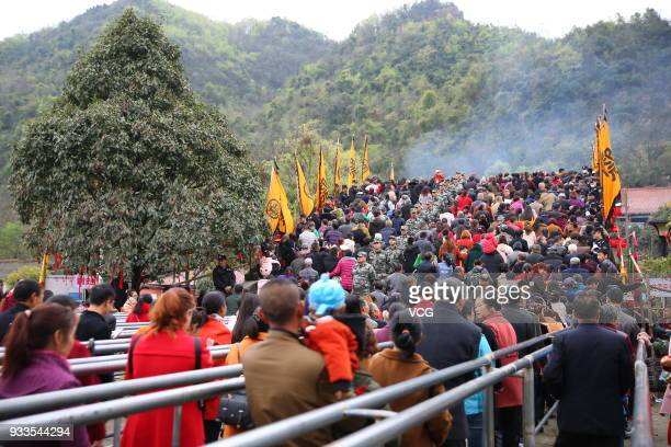 People attend 'treading on bridge' fair to pray for blessing at Jushui Town on March 17 2018 in Mianyang Sichuan Province of China As a traditional...