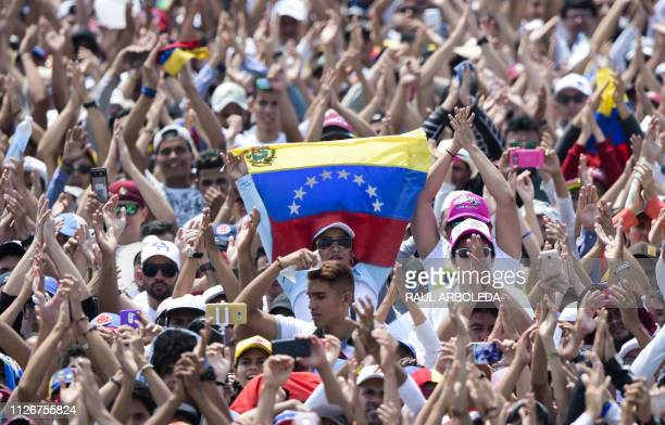 People attend Venezuela Aid Live concert organized to raise money for the Venezuelan relief effort at Tienditas International Bridge in Cucuta...