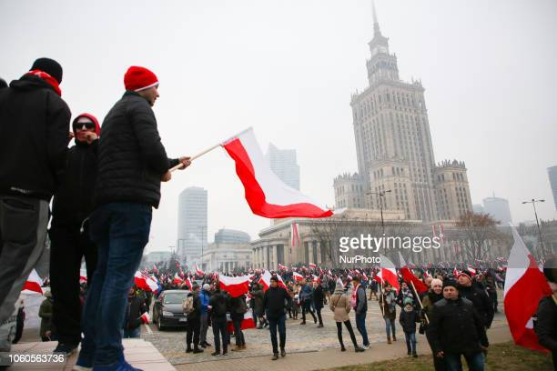 People attend 'White-and-red independence march' to celebrate the 100th anniversary of Poland regaining independence. Warsaw, Poland on 11 November,...