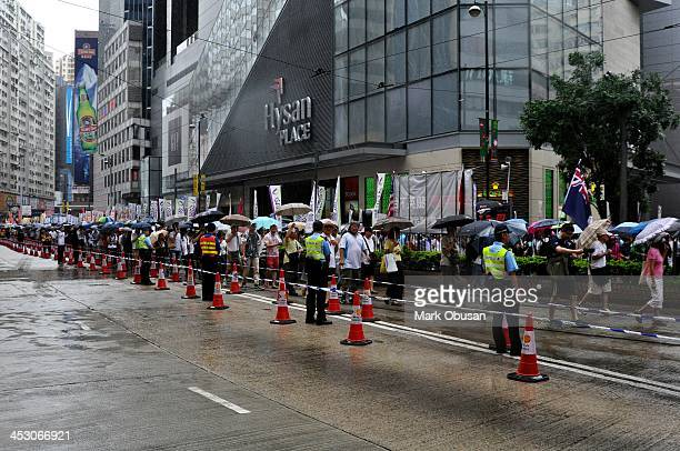 People attended the protest march on 01 July 2013 to press the government of Hong Kong to allow people to vote for their Chief Executive. Typhoon...