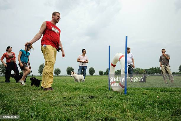 People attending a basic obedience training for puppy dogs