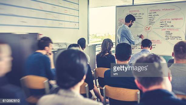 People attending a seminar about CV writing