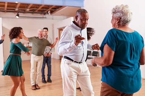 People Attending Dance Class In Community Center 1145054303