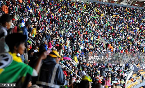 People attending Nelson Mandela's public Memorial Service at the FNB stadium on December 10 in Johannesburg South Africa The Father of the Nation...