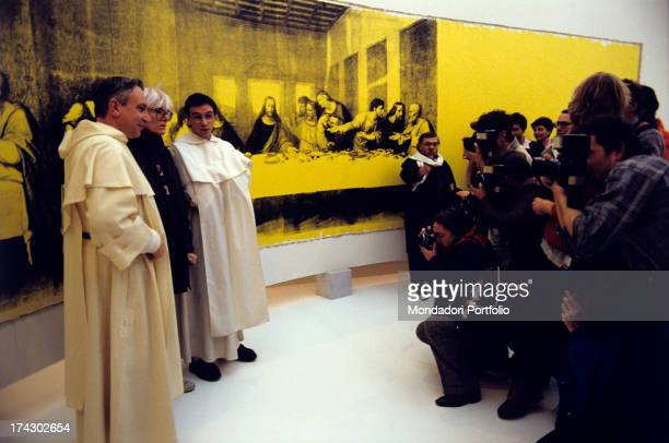People attending the American artist Andy Warhol 's exhibition where the painting The Last Supper is on display Milan 1986