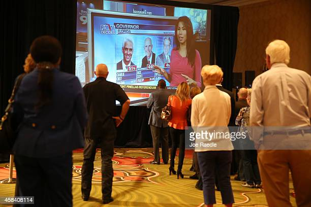 People attending the election night party for former Florida Governor and now Democratic gubernatorial candidate Charlie Crist watch a television for...