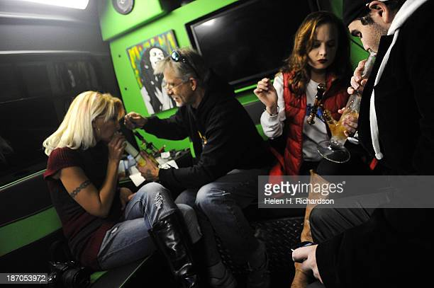 People attending the No on Proposition AA campaign watch party smoke marijuana on the dab bus outside of Casselman's Bar and Venue in Denver Co on...