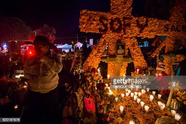 People attends to the graves of loved ones on the eve of the Day of the Dead at the cemetry of Tzintzuntzan in Patzcuaro Michoacan Mexico on November...