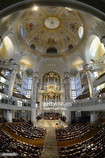 People attent the Frauenkirche that was destroyed in World War II bombings as residents of Dresden eastern Germany commemorate the 70th anniversary...