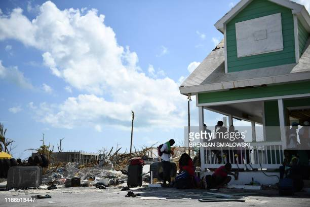 People await evacuation at a dock in Marsh Harbour Bahamas on September 7 in the aftermath of Hurricane Dorian Bahamians who lost everything in the...