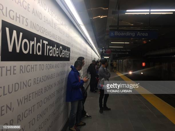 People await the arrival of the underground train at the World Trade Center Cortlandt Street subway station in New York September 9 where just days...
