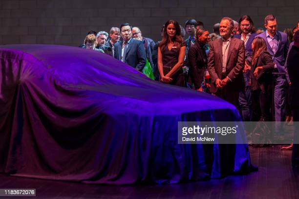 People await the unveiling of Genesis G90 at AutoMobility LA on November 20, 2019 in Los Angeles, California. The four-day press and trade event...