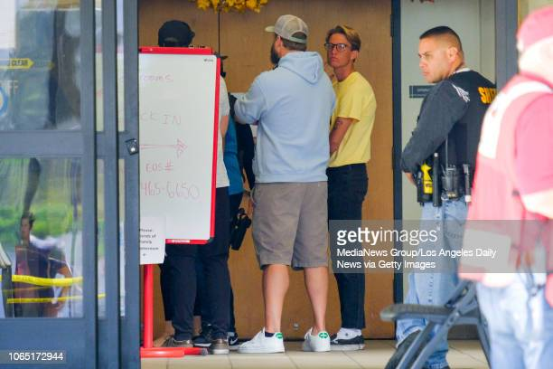 People awaiting word of loved ones from the Borderline Bar & Grill shooting in Thousand Oaks walk between buildings at the Alex Fiore Teen Center in...