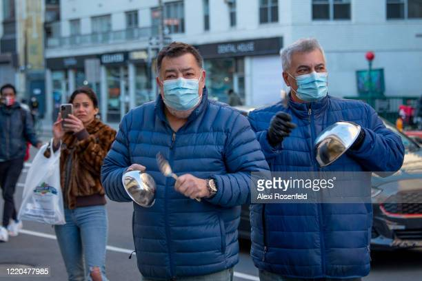 People bang on metal bowls for healthcare workers during the 7 PM nightly cheer outside the Lenox Health Greenwich Village Hospital amid the...