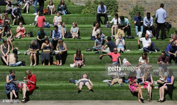 People bask in the sun in north London on July 18 2016 The majority of the country was bathed in sun today with temperatures expected to reach 31C in...