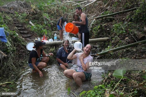 People bathe in spring water since they have no running water in their homes since Hurricane Maria passed through on September 27 2017 in Corozal...