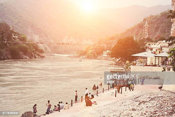 People bathe in the Ganges river in Rishikesh city center