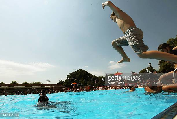 People bathe on opening day of the newly renovated McCarren Park Pool on June 28 2012 in the Brooklyn borough of New York City The historic 37000...