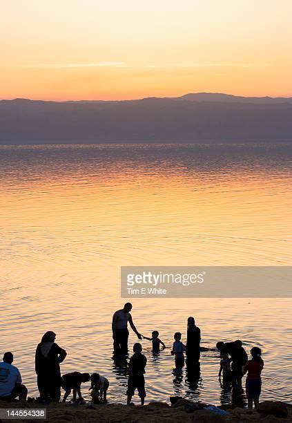People bathing at sunset, Dead Sea, Jordan