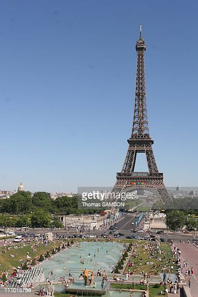 People bathing on the Champs de Mars near the Eiffel Tower in Paris France on June 19th 2005