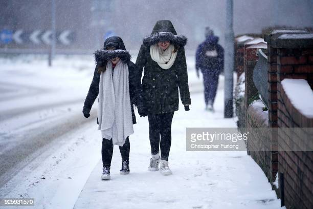 People battle against the snow as Storm Emma and the 'Beast form the East hit South Wales on March 1 2018 in Newport United Kingdom Freezing weather...