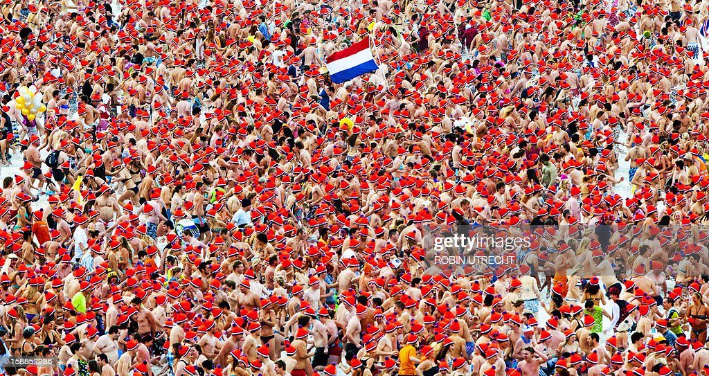 People bearing colors ot the Dutch national flag take a ...