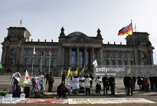 People bearing flags of the Kurdish YPG militia protest against the Turkish military intervention in Afrin province in Syria outside the Chancellery...