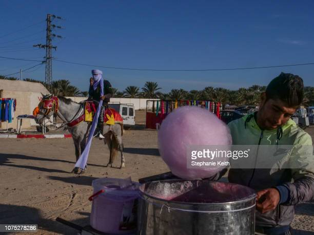 People begin to assemble near the site of the Sahara Festival on the first day of the festival on December 20 2018 in Douz Tunisia The Sahara...