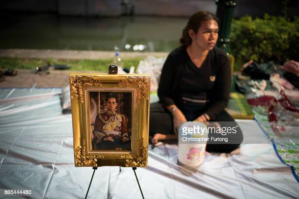 People begin to camp out on the roads surrounding the Royal Palace of Thailand's late King, Bhumibol Adulyadej, in preparation of the King's...