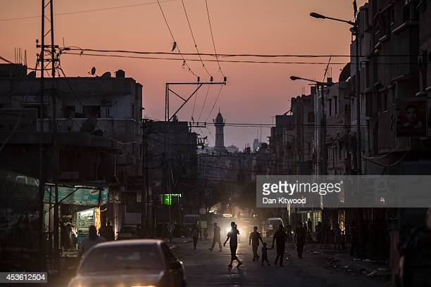 People begin to empty the street at last light on August 14 2014 in Shu Jaia Gaza A new fiveday ceasefire between Palestinian factions and Israel...