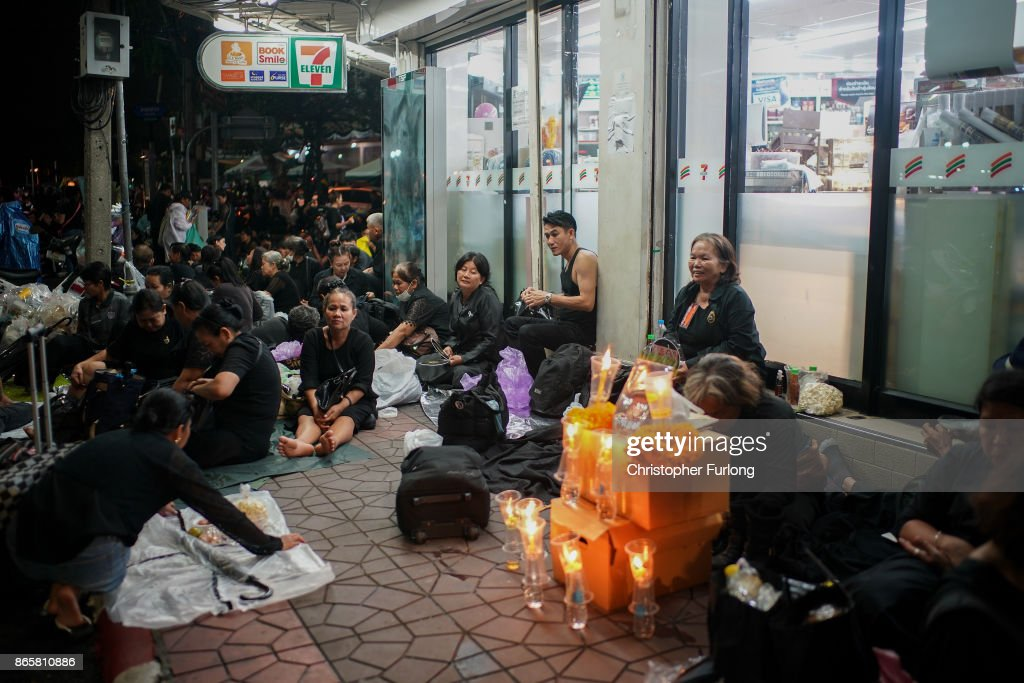 People begin to queue and sleep in shop doorways and on the streets overnight to attend Thailand's late King Bhumibol Adulyadej's cremation and funeral ceremony at the Royal Palace on October 24, 2017 in Bangkok, Thailand. The world's longest serving monarch King Bhumibol Adulyadej died on October 13, 2016. Rehearsals for the five day funeral of the much loved king are taking place around Bangkok's Grand Palace. The ceremonies will take place over five days culminating in the cremation of the king's body in a grand Royal Crematorium on October 26th.